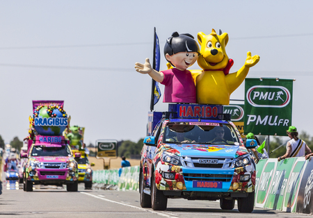 Saint Aoustrille, France-July 12,2013  Haribo vehicles during the passing of the advertising caravan at the intermediate sprint point during the stage 13 of the 100 edition of Le Tour de France, the biggest cycling race in the world, on 12 July 2013 in Sa