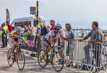 Mont Ventoux, France- July 14 2013  The French cyclist Jean-Christophe Peraud   Ag2r-La Mondiale Team  and and the Belgian cyclist Bart De Clercq  Lotto-Belisol Team , climbing the last kilometer of the ascension to Mont Ventoux during the stage 15 of the