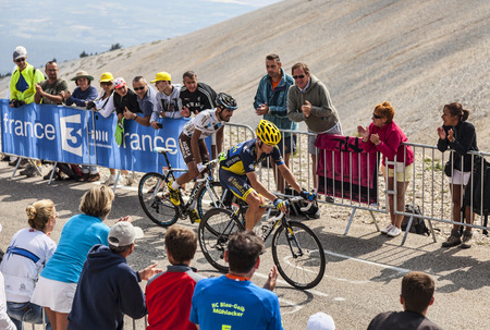 Mont Ventoux, France- July 14 2013  The French cyclist Christophe Riblon  Ag2r-La Mondiale Team  and and the Irish cyclist Nicolas Roche  Team Saxo-Tinkoff Team , climbing the last kilometer of the ascension to Mont Ventoux during the stage 15 of the 100