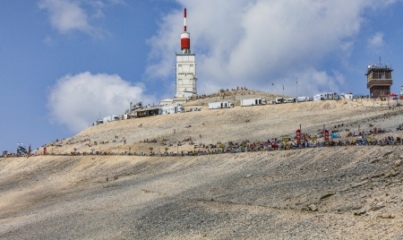 apparition: Mont Ventoux, France- July 14 2013  Fans on the roadside to the top of Mount Ventoux few hours before the apparition of the cyclists during the stage 15 of the 100 edition of Le Tour de France 2013