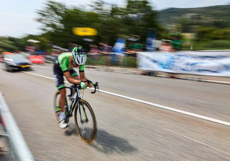 mount tom: Chorges, France- July 17, 2013 Panning image of the Dutch cyclist Tom Leezer from Belkin Pro Cycling Team pedaling during the stage 17 of 100th edition of Le Tour de France 2013, a time trial between Embrun and Chorges
