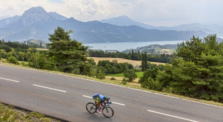 daniele: Chorges, France- July 17, 2013  The Italian cyclist Daniele Bennati from Team Saxo-Tinkoff pedaling during the stage 17 of 100th edition of Le Tour de France 2013, a time trial between Embrun and Chorges In the background is the lake Serre-Poncon and maou