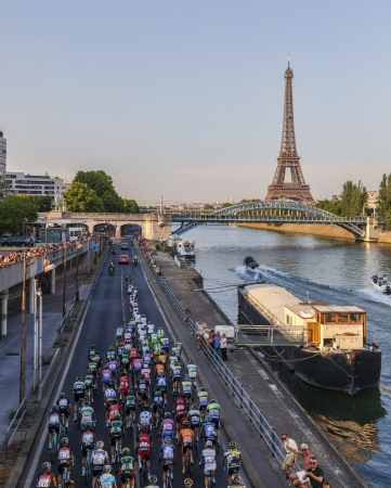 Paris, France- July 21st, 2013  The peloton riding on the Seine riverside near the Eiffel Tower during the last stage of the 100th edition of Le Tour de France 2013, in Paris