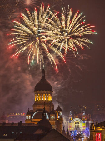 urbanscape: Beautiful fireworks show takes place in Avram Iancu Square in Cluj Napoca with the ocassion of The Romanian National day on 1 December 2013 in Cluj Napoca, Romania