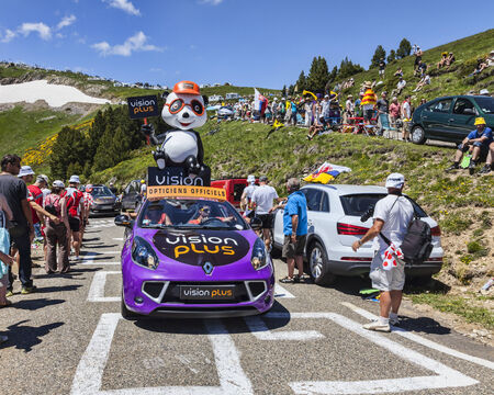 Port de Pailheres,France- July 06 2013 Vision Plus car during the passing of the advertising caravan on the climbing route to mountain pass Pailhere in Pyrenees Mountains during the 8th stage of the 100 edition of Le Tour de France, the biggest cycling ra Stock Photo - 25981880
