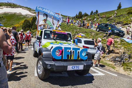 Port de Pailheres,France- July 06 2013 CFTC  The French Confederation of Christian Workers   car during the passing of the advertising caravan on the climbing route to mountain pass Pailhere in Pyrenees Mountains during the 8th stage of the 100 edition of