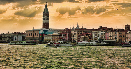 campanille: Venice,Italy- July 30, 2011  Beautiful colorful sunset over the Venetian lagoon
