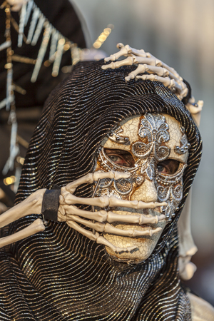 gruesome: Venice,Italy- February 18, 2012  Environmental portrait of an unidentified person wearing a scary skeleton disguise during the Venice Carnival days  Editorial
