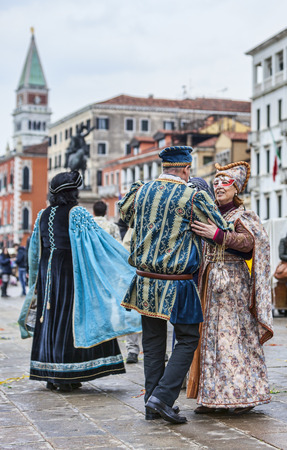 campanille: Venice, Italy- March 02, 2014  Unidentified happy couples wearing traditional clothes dance on Sestiere Castello in Venice during the Carnival days  Editorial