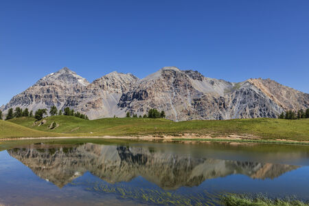 gaspard: Le Rois Mages  Baltazar 3153m, Melchior 2948 m, Gaspard 2808 m , Quatre Soeurs 2587 m  and their reflection in the lake Chavillon on Etroite Valley- Hautes-Alpes