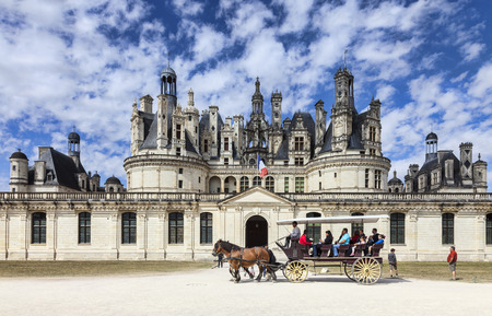 Chambord,France-September 08,2013  A carriage with tourists passing in front of the Chambord Castle  Chambord is royal medieval French castle in Loire Valley - UNESCO heritage site