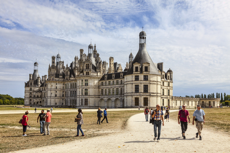 Chambord,France-September 08,2013 Tourists walking on alleys near the Chambord Castle Chambord is royal medieval French castle in Loire Valley - UNESCO heritage site