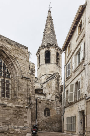 avignon: Image of an old stone church and a narrow street in Avignon in South of France