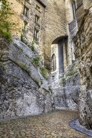 avignon: Very interesting rocky street in Avignon in the South of France  Rue de la Peyrolerie In the past this street, dug into the rock, was a peyriera  career , than it became the brazier Stock Photo