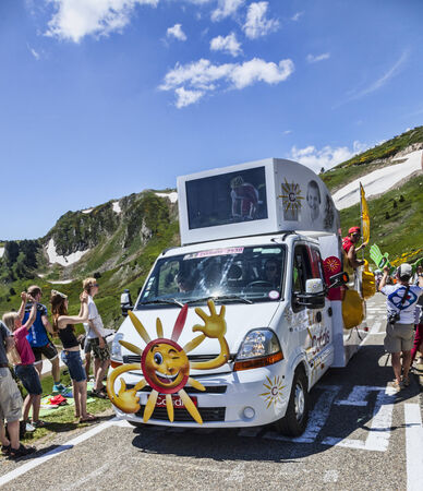 Port de Pailheres,France- July 06 2013 Cofidis vehicle during the passing of the advertising caravan on the climbing route to mountain pass Pailhere in Pyrenees Mountains during the 8th stage of the 100 edition of Le Tour de France, the biggest cycling ra Stock Photo - 28307099