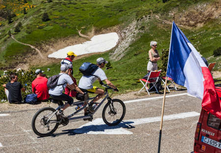 Port de Pailheres,France- July 6, 2013  An amateur cyclist couple using a tandem bicycle climbs the difficult road to the Col de Pailheres in Pyrenees Mountain before the apparition of the peloton during the stage 8 of edition 100 of Le Tour de France 201