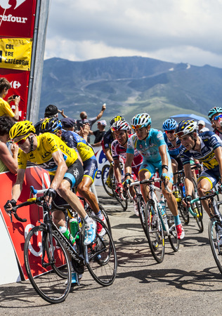 Col de Val Louron-Azet, France- July 07,2013  The British cyclists Christopher Froome  Sky Procycling Team  wearing The Yellow Jersey and a group of cyclists from various teams passing the Col de Val Lauron-Azet during the stage 9 of 100 edition of Le Tou