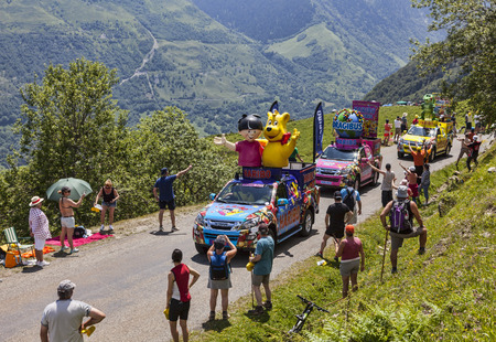 Col de Val Louron-Azet, France- July 07,2013  Haribo vehicles during the passing of the advertising caravan on  the road to Col de Val Louron Azet in Pyrenees mountains before the apparition of the peloton during the stage 9 of the 100 edition of Le Tour