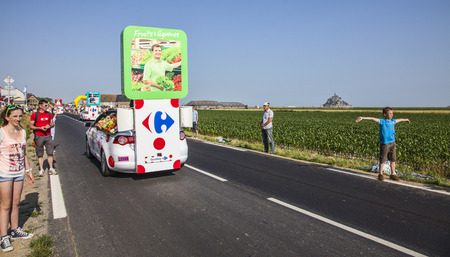 carrefour: Ardevon, France- July 10, 2013  Carrefour truck during the passing of the publicity caravan during the stage 11 of the edition 100 of Le Tour de France 2013, a time trial between Avranches and Mont Saint Michel