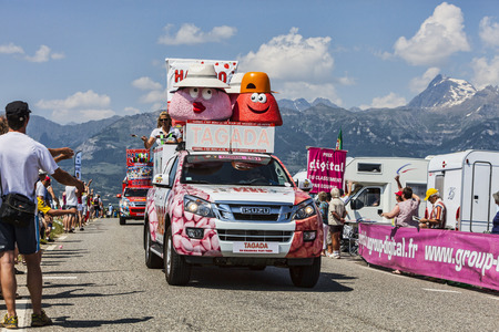 Col de Manse, France- July 16, 2013  Haribo vehicles during the passing of the publicity caravan on a plain road after the ascension to Col de Manse in The Alps during the stage 16 of 100th edition of Le Tour de France 2013 Haribo is the biggest manufactu