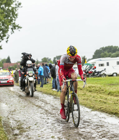 rein: Ennevelin, France - July 09,2014  The Estonian cyclist Rein Taaramae  Cofidis Team  riding on a cobbled road during the stage 5 of Le Tour de France 2014