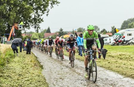 Ennevelin, France - July 09,2014  The Dutch cyclist Lars Boom  Belkin Team  riding on a cobbled road during the stage 5 of Le Tour de France 2014  In the end he was the winner of this important stage of the 2014 race