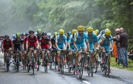 Col de Platzerwasel,France - July 13, 2014  Astana Team and BMC Team ride in front of the peloton on the climbing road to mountain pass Platzerwasel in Vosges Mountains, during the stage 10 of Le Tour de France 2014  Team Astana try to help Vincenzo Nibal