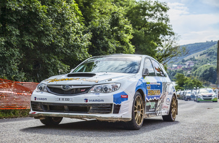 subaru: Tarnita,Romania- 21 06 2014  Manfred Stohl Tina Monego team  Subaru Impreza N  takes the start in Tarnita during the second day of Transylvania Rally, Cluj,Romania 19-21 06 2014  This team finished the competition on the 5th position
