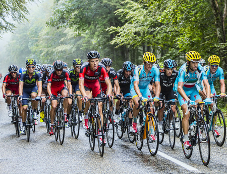 Col de Platzerwasel, France - July 14, 2014  Vincenzo Nibali  Team Astana  and Richie Porte  Team Sky   figting for the first two positions in the general calssification, ride inside the peloton while climbing the  road to Mountain Pass Platzerwasel, in V