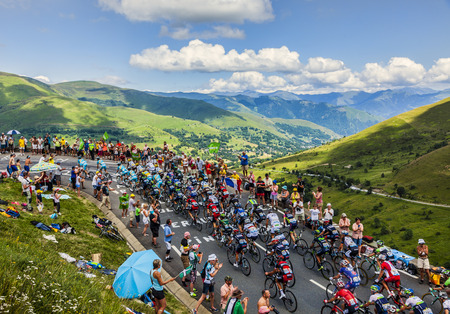 Col de Peyresourde,France- July 23, 2014  The peloton climbing the road to Col de Peyresourde in Pyrenees Mountains during the stage 17 of  Le Tour de France on 23 July 2014