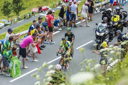 Col de Peyresourde,France- July 23, 2014  The cyclists Nicolas Roche   Team Tinkoff-Saxo   and Jesus Herrada Lopez  MovistarTeam  climbing the road to Col de Peyresourde in Pyrenees Mountains during the stage 17 of  Le Tour de France on 23 July 2014
