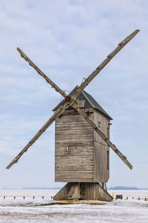 Traditional wooden windmill during the winter, located in the Eure&Loir region of France.This windmill is The big windmill from Ouarville. photo