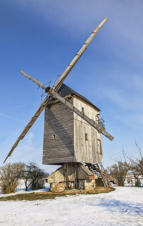 Traditional wooden windmill in the Eure&Loir region of France during the winter.This windmill is from Chesnay. photo