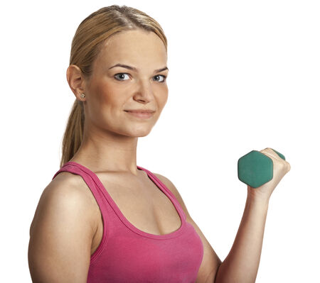 Portrait of a beautiful young blonde girl holding a green dumbbell isolated against a white background. photo