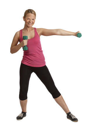 Young blonde woman doing exercise with dumbbells isolated against a white background. photo