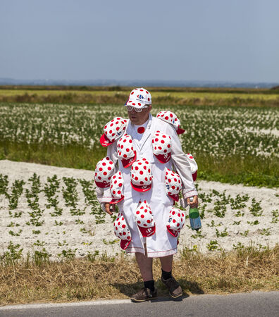 vicinity: e Pont Landais,France-July 10, 2013: Unidentified man funny disguised walking in the vicinity of Le Mont Saint Michel monastery during the stage 11 of the edition 100 of Le Tour de France 2013, a time trial between Avranches and Mont Saint Michel.