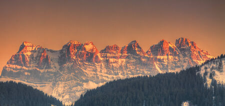 swiss insignia: Sunset over the pics on Dents du Midi situated in the Chablais Alps in the Swiss canton of Valais.