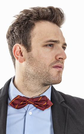 profil: Profil of a young businessman with a red bow, against a white background. Stock Photo