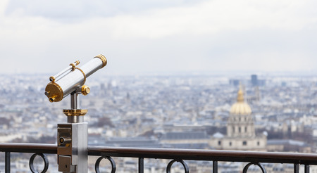 Telescope located on the first level of The Eiffel Tower useful for admiring the Parisian panorama surrounding The Thomb of Napoleon. photo