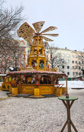 christkindlmarkt: Munich,Germany- Decemeber 19, 2010: Traditional wooden carousel located outside in a Christmas Market in downtown Munich,Germany.