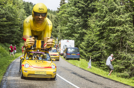 Col de Platzerwasel, France - July 14, 2014: The specific LCL yellow mascot during the passing during the Publicity Caravan in front of the audience on the road to Mountain Pass Platzerwasel, in Vosges mountains, during the stage 10 of Le Tour de France 2
