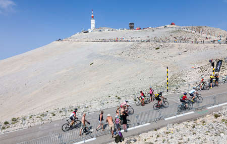 apparition: Mont Ventoux, France- July 14 2013: Amateur cyclists climbing the road to Mount Ventoux before the apparition of the competitiors in the stage 15 of the 100 edition of Le Tour de France 2013.