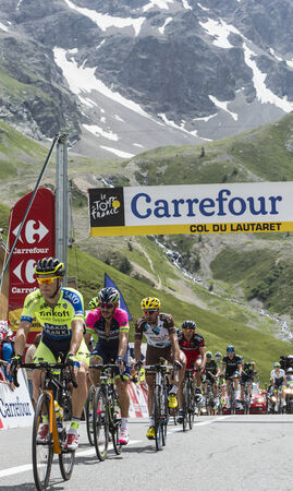 Col du Lautaret, France - July 19, 2014: Group of cyclists ( Nicolas Roche-Tinkoff-Saxo, José Serpa- Lampre-Merida, Christophe Riblon-Ag2r-La Mondiale ) arrived first on mountain pass Lautaret during the stage 14 of Le Tour de France 2014. Editorial