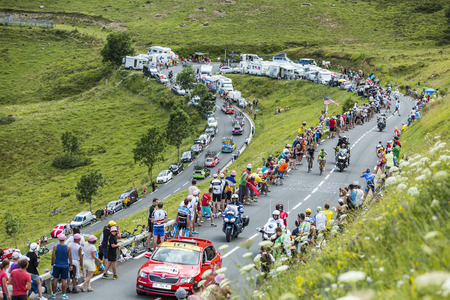 tout: Col de Peyresourde,France- July 23, 2014: The cyclists Nicolas Roche ( Team Tinkoff-Saxo ) and Jesus Herrada Lopez (MovistarTeam) climbing the road to Col de Peyresourde in Pyrenees Mountains during the stage 17 of Le Tour de France on 23 July 2014. Editorial