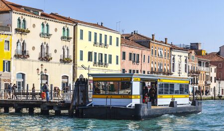 waterbus: Venice, Italy- February 26th, 2011: Image of a Vaporetto reaching the San Basilio Station on The Grand Canal in Venice during the Carnival days.