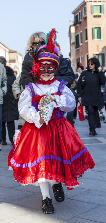 Venice,Italy,February 26th 2011: Unidentified kid traditionally disguised marching on a street in Venice during the Carnival days. Editorial