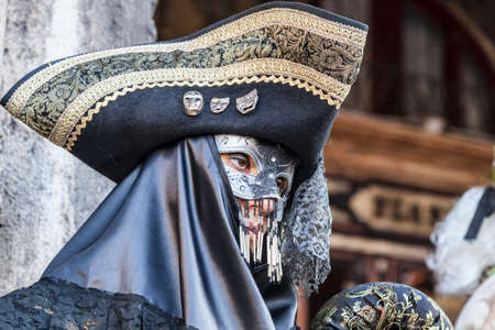 18th: Venice, Italy- February 18th, 2012: Portrait of a disguised person with a tricorn during the Venice Carnival days.