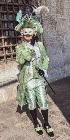 cel: Venice, Italy- February 18th, 2012: Man disguised in a beautiful costume as the count Casanova posing during the Venice Carnival days.