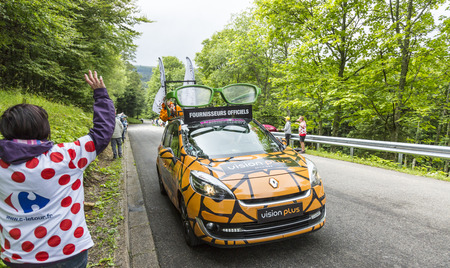 publicity: Le Markstein, France- July 13, 2014:Vehicle advertising Vision Plus during the passing of the Publicity Caravan in front of exciting spectators, on mountain pass Le Markstein during the stage 9 of Le Tour de France 2014.Vision Plus in an important French