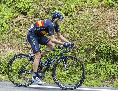 mountain bicycling: Col du Tourmalet, France - July 24,2014: The cyclist Jon Izagirre Insausti (MovistarTeam) climbing the difficult road to Col du Tourmalet in Pyrenees Mountains during the stage 18 of Le Tour de France 2014.